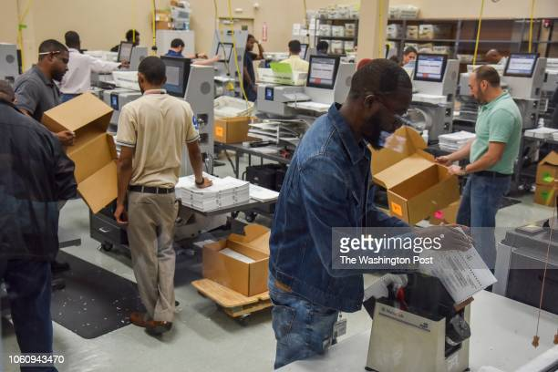 Election workers sort ballots so that the Florida senate and governor votes can be separately recounted at the Broward County Supervisor of Elections...