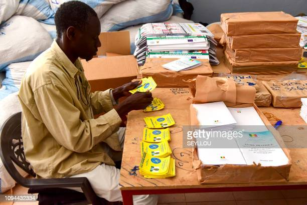 Election workers sort through election material at the national police academy in Dakar on February 6 ahead of the first round of the presidential...