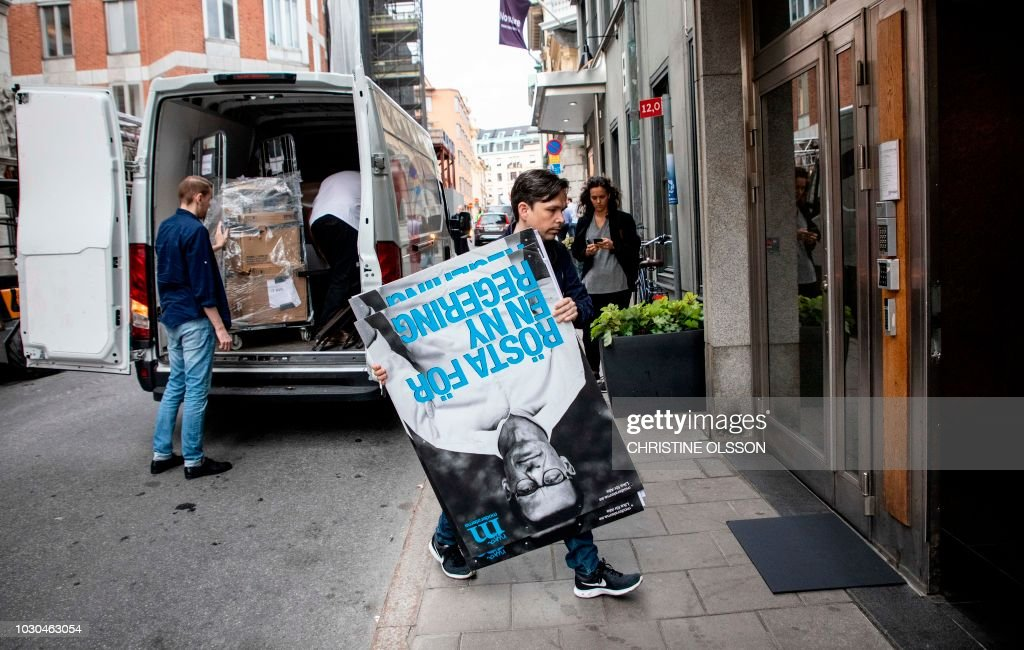 Election workers unload posters with a portrait of Moderate Party leader Ulf Kristersson outside the party headquarters in central Stockholm, Sweden, on September 10, 2018, the day after general elections in Sweden. - Sweden faced political deadlock after the far-right made gains in legislative elections that left the question of who will form the next government up in the air. (Photo by Christine Olsson / TT News Agency / AFP) / Sweden OUT