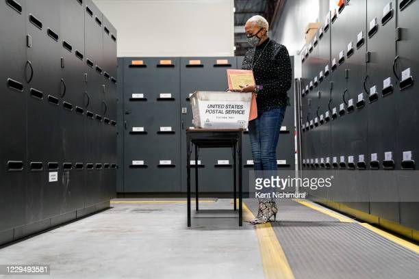 Election workers validate ballots at the Gwinnete County Elections Office on Friday, Nov. 6, 2020 in Lawrenceville, GA. With the surge in vote by...