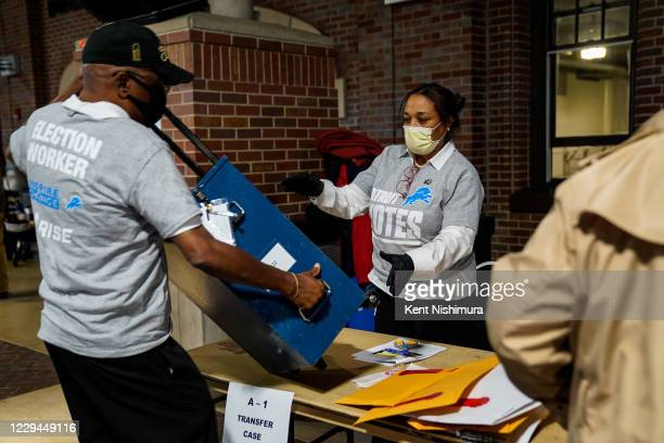 Election workers wait as they go through the ballot transfer process on Election Day, Tuesday, Nov. 3, 2020 in Detroit, MI. Preceded by an...