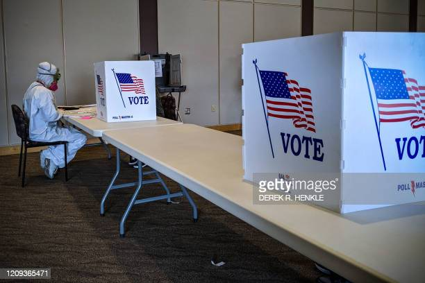 TOPSHOT Elections Chief Inspector Mary Magdalen Moser runs a polling location in Kenosha Wisconsin in full hazmat gear as the Wisconsin primary kicks...
