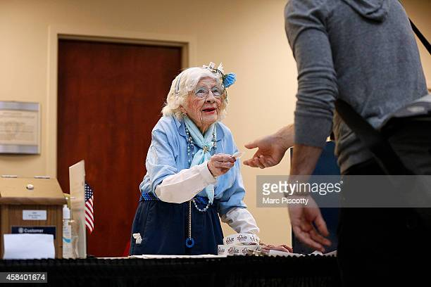 Elections judge Constance Rolon of Denver Colorado hands out 'I Voted' stickers as voters cast their ballots at the Denver Elections Division...