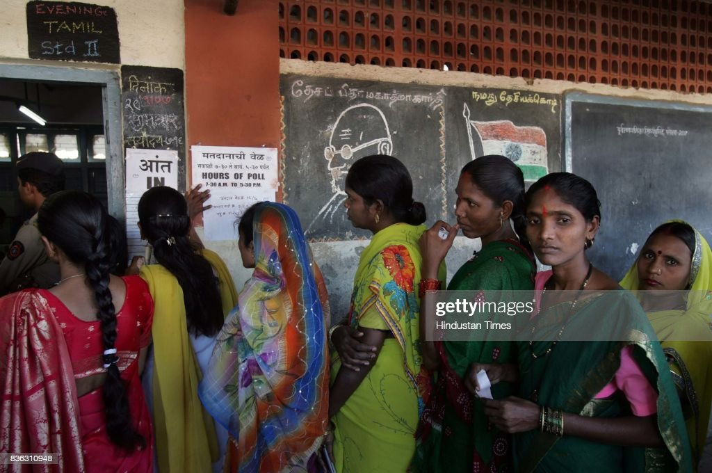 People wating in queue for BMC election at Malvani Sector No. 8 on Thursday.