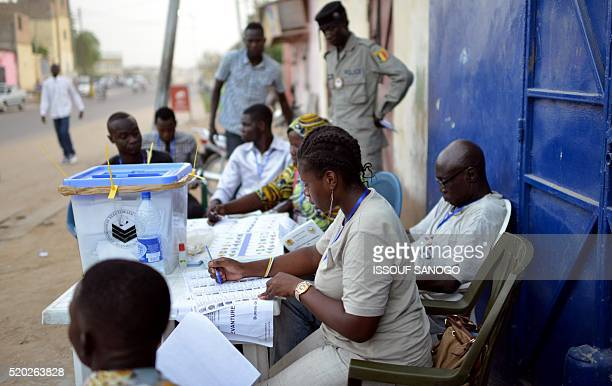 Elections workers control the votes in the street during Chad's presidential election in N'djamena on April 10 2016 Chadians voted in an election...