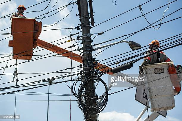 Electiricians repair a broken cable after a 14-story building collapsed by unknown reasons in downtown Sao Bernardo do Campo, about 25km south of Sao...