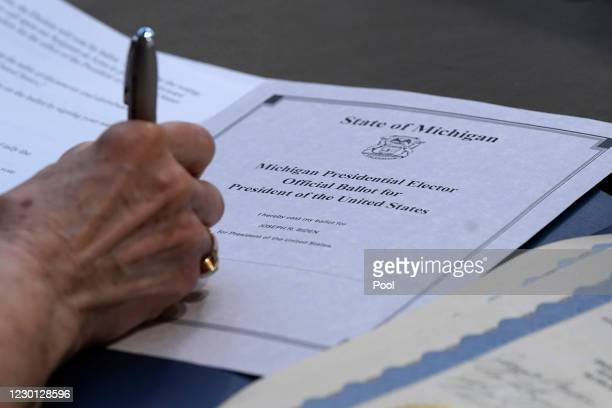 Electoral College elector Bobbie Walton signs her ballot for President of the United States at the state Capitol on December 14, 2020 in Lansing,...