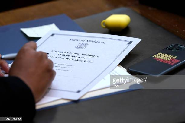 Electoral College elector Marseille Allen signs her ballot for President of the United States at the state Capitol on December 14, 2020 in Lansing,...