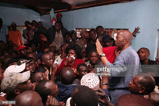 Electoral commission of Kenya Chairman Samuel Kivuitu right speaks with irate voters whose names were missing from the electoral roll in Kibera...
