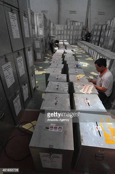 Electoral Commission Officer inserts ballots and seals the box during the preparation of the Presidential Election in Surakarta Central Java...