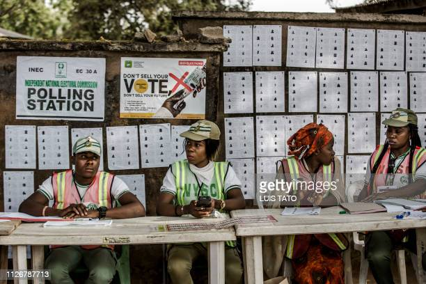 TOPSHOT Electoral Commission Officers await for voters as a polling station opens at Agiya polling station in Yola Adamawa State Nigeria on February...