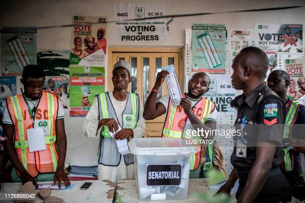 Electoral commission officers count votes at Shagari Health Unit polling station in Yola Adamawa State on February 23 2019 after the polls were...
