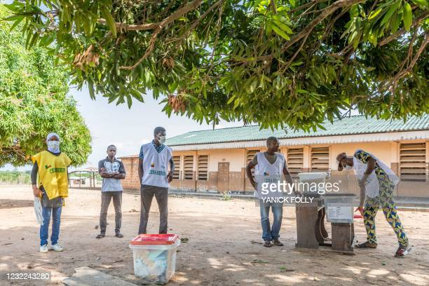 Electoral commission officials set up a ballot boxes at a polling station at the Dakpa primary school in Save, Benin, on April 11 while waiting for...
