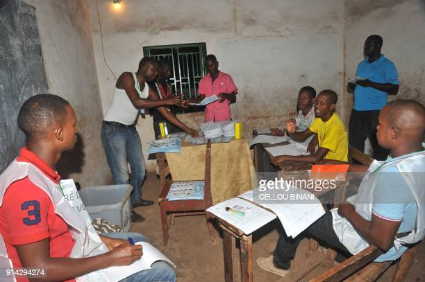 Electoral Commission workers count ballot papers at a polling station in Conakry on February 4 2018 following the country's first local council and...