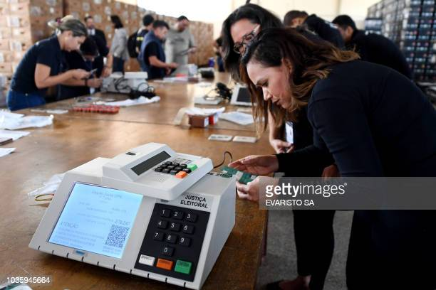 Electoral Court officials prepare electronic voting machines for Brazil's upcoming general election in Brasilia on September 19 2018 Brazil will hold...