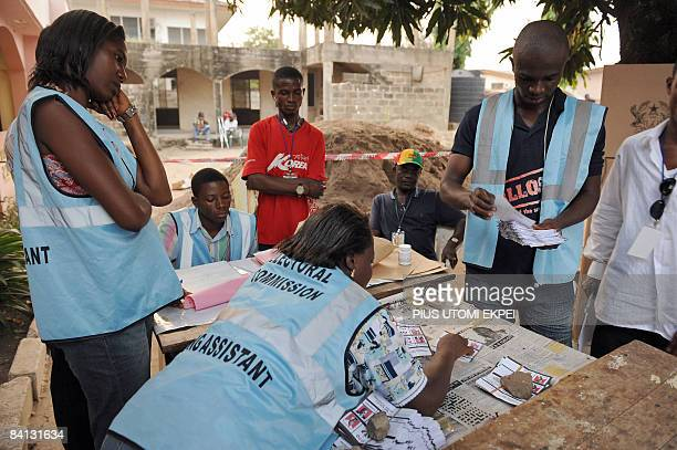 Electoral officer count the ballots at a polling station after the presidential elections on December 28 in Accra Ghanaians turned out today to...