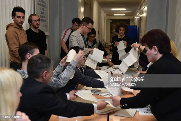 Electoral officers count the ballot papers at a polling station in Kiev after the first round of Ukraine's presidential election on March 31 2019...