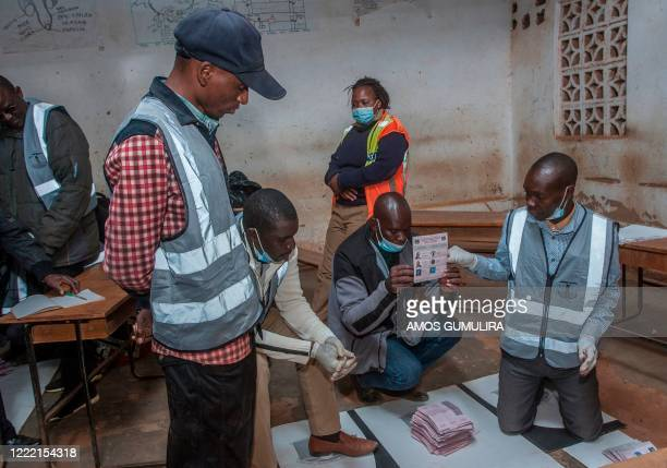 Electoral officials and political party monitors count votes during the presidential elections during the presidential elections at the Mighty Caspia...