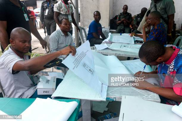 Electoral officials collect results at the state headquarters of the Independent National Electoral Commission in Port Harcourt Rivers State on March...