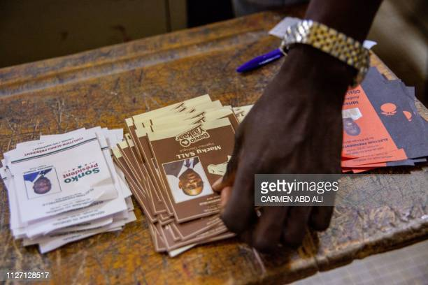 Electoral officials count ballots at a polling station at the Dakar Plateau Adja Mame Yacine Diagne School in Dakar on February 24 2019 Senegal went...