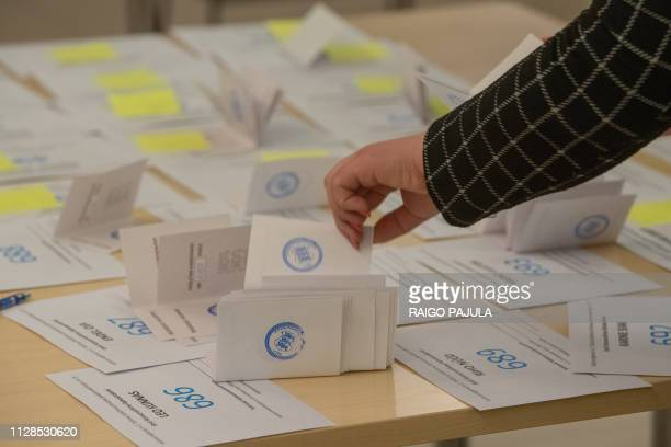 Electoral officials count ballots at a polling station during Estonia's general election in Tallin on March 3 2019 Estonias centreleft coalition is...