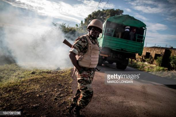 Electoral officials leave onboard of a truck with polling materials ahead of deployment in Buea southwestern Cameroon on October 7 2018 during...