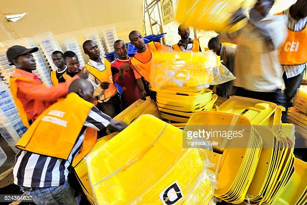 Electoral officials of the Democratic Republic of Congo prepare ballot material for the presidential election at a MOUSCO warehouse at Goma airport...