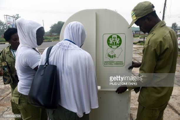 Electoral officials try to assemble a polling booth during the Osun State gubernatorial election in Ede in the Osun State in southwest Nigeria on...