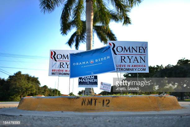 Electoral placards supporting US President Barack Obama and his Republican rival Mitt Romney are seen near Lynn University in Boca Raton Florida on...