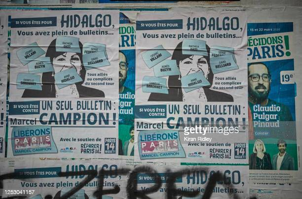 Electoral posters against Paris Mayor Socialist Anne Hidalgo who is fighting for a second term as Parisians go to the polls today in the second round...
