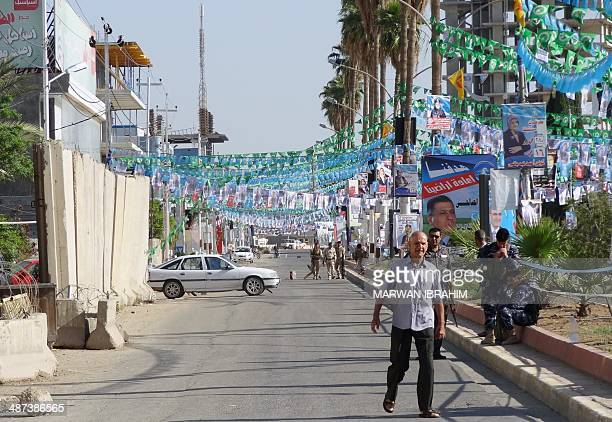 Electoral posters are seen in the street in the northern Iraqi city of Kirkuk as Iraqis head to the polling stations to cast their votes in Iraq's...