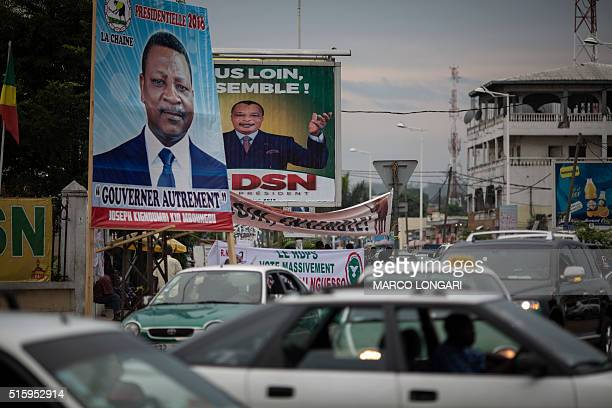 Electoral posters of Congolese candidates to the second round of the presidential elections are seen at a busy intersection in Brazzaville on March...
