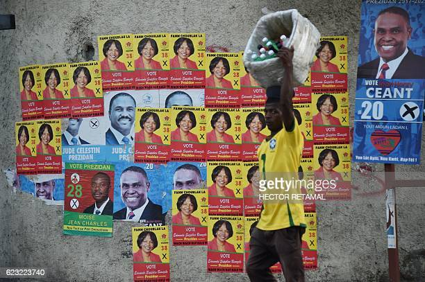 Electoral posters of presidential candidates are seen on a street in the commune of Petion Ville in the Haitian capital PortauPrince on November 14...