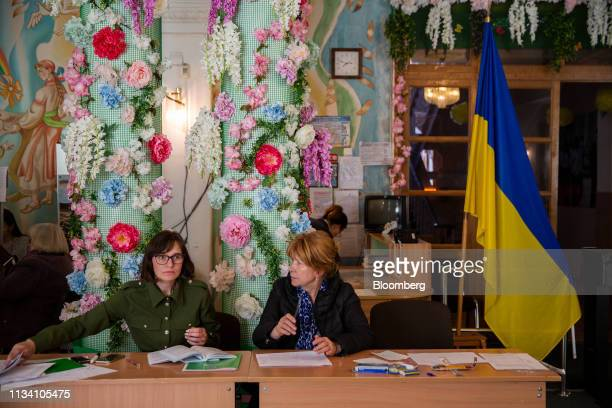 Electoral staff organise voting materials at a polling station in Kiev Ukraine on Sunday March 31 2019 Ukrainians will choose between a field of...