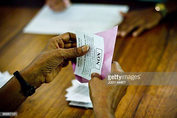 A electoral worker counts ballots in the polling station of Cayenne on the French South American territory of Guiana on January 10 for the referendum...