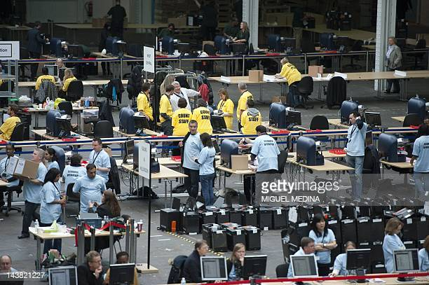 Electorial count staff tally the votes for the local elections at Olympia conference centre in London on May 4 2012 Prime Minister David Cameron's...