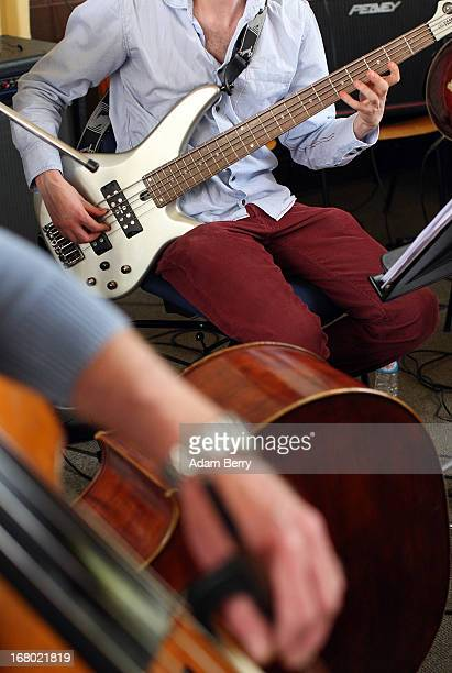 Electric and acoustic bass players in the ORSO Rock Symphony Orchestra rehearse for the ORSO RockSymphonyNight in the Evangelische PhilippusNathanael...
