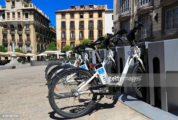 Electric BiciMAD bikes charging up in Madrid