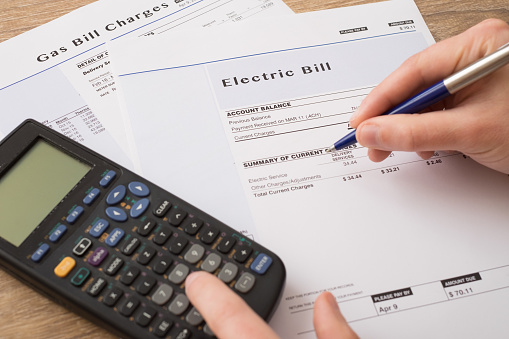 Electric bill charges paper form on the table 626249002