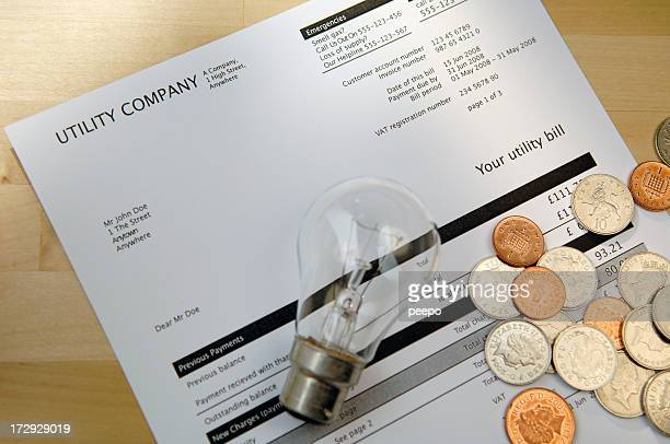 Electric Bill with lightbulb and coins.