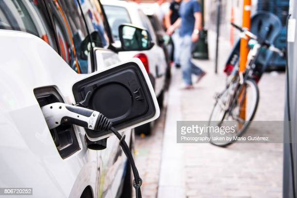 electric car being charged - hybrid car stock photos and pictures