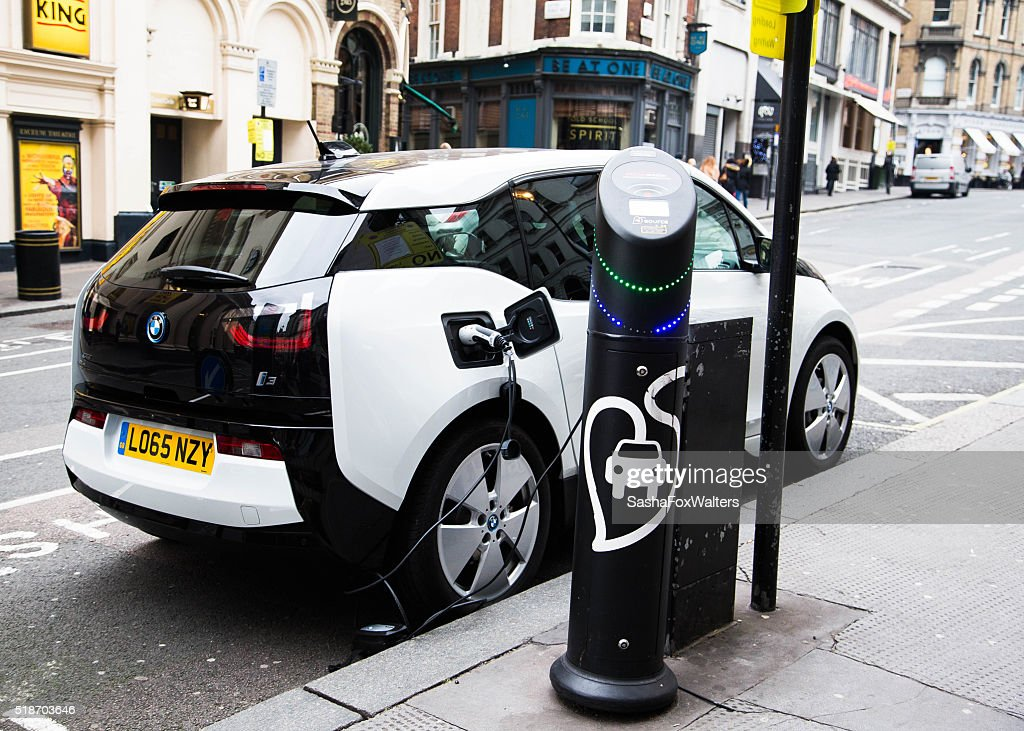 Electric car being recharged at a meter in London, UK : Stock Photo