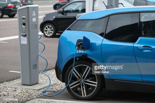 Electric car charges its battery outside the BMW factory on May 20, 2019 in Leipzig, Germany. The I3 is made at the Leipzig plant.