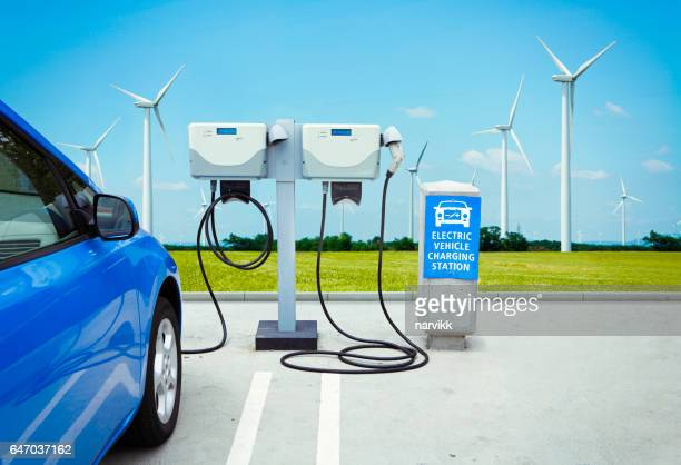 electric car charging green energy - electric vehicle charging station stock photos and pictures