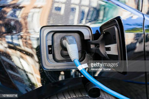 Electric car charging on the street