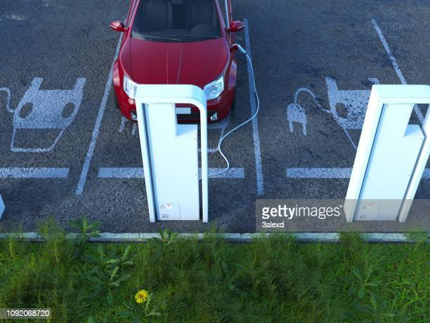 electric car charging - electric vehicle charging station stock pictures, royalty-free photos & images