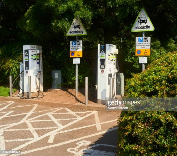 electric car charging - alternative fuel vehicle stock pictures, royalty-free photos & images