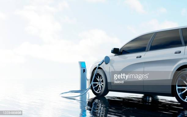 electric car charging - electric vehicle stock pictures, royalty-free photos & images