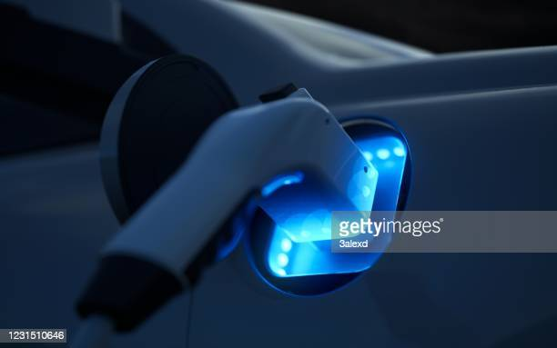electric car charging - electric car stock pictures, royalty-free photos & images