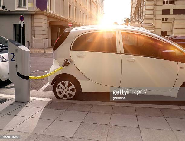 electric car charging - hybrid car stock photos and pictures